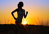 Young Beautiful Woman Running on the Mountain Trail in the Morning