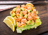 Salad with salmon, avocado and lettuce