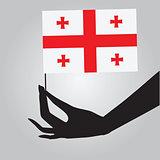 Hand with Georgia flag