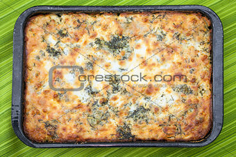 Cauliflower baked with eggs, cheese and parsley on top