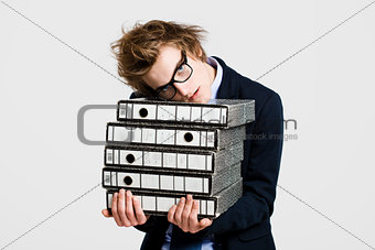 Business man carrying folders