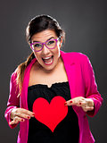 Funny woman holding a heart