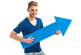 Young man holding a blue arrow