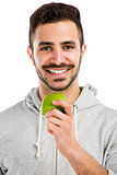 Man tasting a green fresh apple