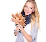 Happy woman with dry leaves