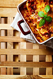 Italian Food. Lasagna plate on wooden table.