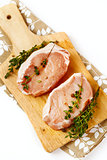 Fresh raw pork steaks on cutting board