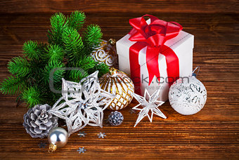 Branch of Christmas tree with gift