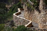 winding stone staircase in the mountains