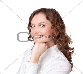 Portrait of pretty young businesswoman with hand on chin and smi