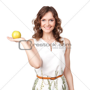 Portrait of an attractive young woman with an apple