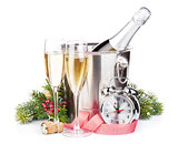 Christmas champagne with alarm clock and fir tree