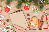 Christmas fir tree, decor, gingerbrean man and blank notepad