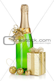 Champagne bottle, christmas gift and baubles