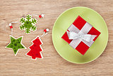 Christmas decor and gift box on plate