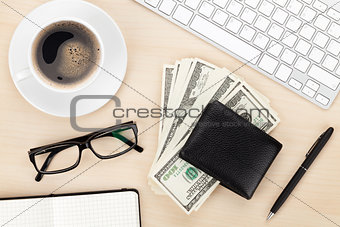 Office table with pc, supplies, coffee cup and money cash