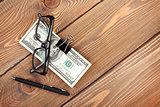 Money cash, glasses and pen