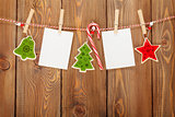 Photo frames and christmas decor on rope