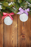 Christmas fir tree and baubles with colorful ribbon