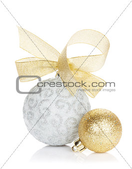 Christmas baubles and golden ribbon