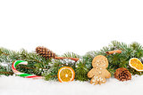 Christmas food and decor over snow fir tree