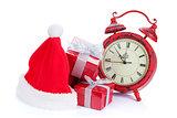 Christmas clock, gift boxes and santa hat