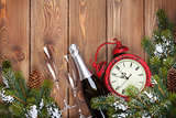 Christmas wooden background with clock, champagne and snow fir t