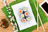 Sushi maki set, green tea and sakura branch