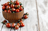 Black cherry tomato background