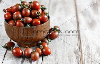 Black cherry tomato background