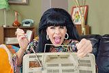 Lady Adjusting TV Antenna