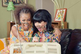 Pair of Ladies Laughing at TV