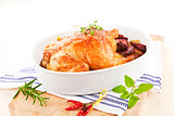 Delicious chicken with fresh herbs and vegetables.