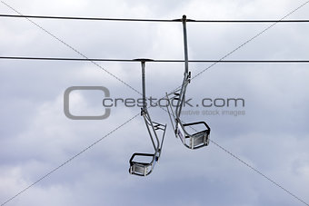 Chair-lift and overcast sky