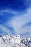 Winter snowy mountains at windy day