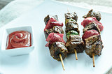Grilled beef skewers with pepper and brussels