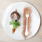 Warm chocolate cake Fondant with ice-cream ball, almond, mint, c