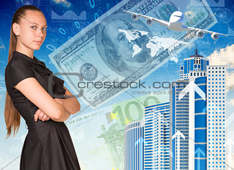Beautiful businesswoman in dress with crossed arms. Buildings and money as backdrop