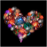 a group of exploding fireworks shaped like a heart.