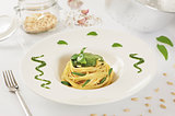 pasta spaghetti with pesto with white background