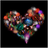 a group of exploding fireworks shaped like a heart.