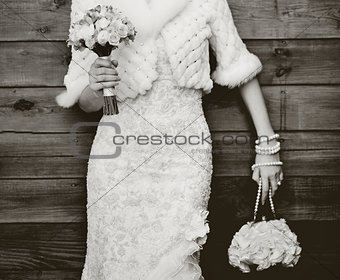 Beautiful young bride with bouquet.