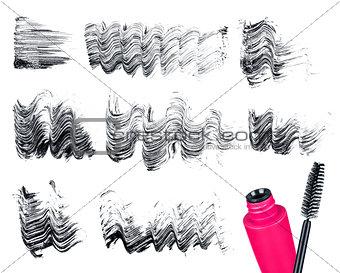 Mascara brush and strokes isolated on white
