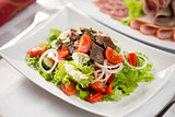 Vegetable salad with beef meat