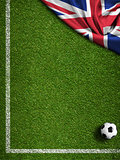 Soccer field with ball and flag of United Kingdom