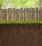 garden soil with wooden fence