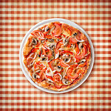 pizza with paprika and mushrooms top view on old picnic tableclo