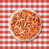 pizza with paprika and mushrooms top view on picnic tablecloth