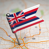 Hawaii Small Flag on a Map Background.