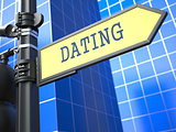 Dating - Signpost on Blue Background.